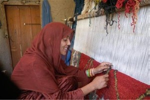 Women in eastern Afghanistan like Musharaba are now enjoying newfound confidence and skills in carpet weaving and literacy thank