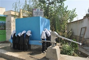 AFTER Now the schoolgirls can drink or wash at an array of taps set into a tank that holds water supplied by the new solar pump.