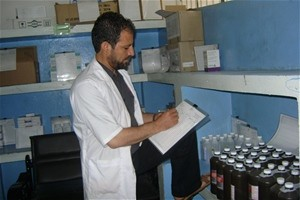 Pharmacist Zakhi Ahmad Qiami records medicines on a stock card in the pharmacy at the Indira Gandhi Children's Hospital in Kabul