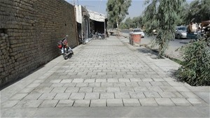 A section of completed sidewalk in a densely populated sub-district in Kandahar.