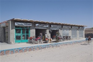 New shops open atop sidewalks and retaining walls restored by local laborers in Dehrawud District, Uruzgan Province.
