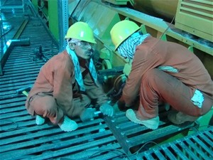 Trainees at the Tarakhil power plant install a fabricated platform that provides access to the turbines and other machinery. The