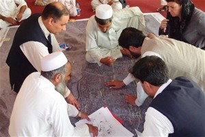 "Local engineers and city planners create the map ""Who Does What, Where"" in Jalalabad City."