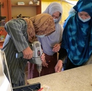Women learn vocational skills at the Afghan Women's Initiatives organization through funding and support from USAID.