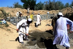 Pul-i-Alam residents, including Kuchi tribe members, work to restore damages sectionsof the Shahi canal.