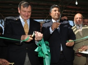 U.S. Ambassador Karl W. Eikenberry (left) and Minister of Agriculture, Irrigation and Livestock Asif Rahimi cut the ribbon to op