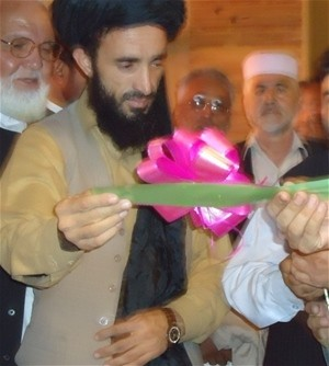 The deputy of Nangarhar provincial council (center) and other government representatives cut the ribbon to open the Jalalabad Ci