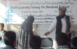 Shindand District Governor, Lal Mohammad Omarzai hands out certificate during the closing ceremony in October 2010.