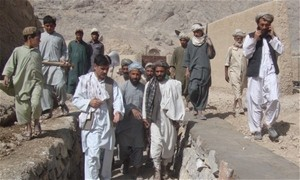 The sub-district manager monitors a project site and meets his constituents in sub-district six of Kandahar Province.