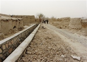 AFTER Following construction of a 115-meter erosion protection wall and backfilling, the village is now accessible to produce bu