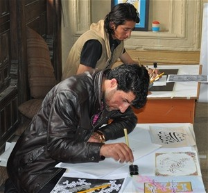 Students taking the calligraphy test at the Institute for Afghan Arts & Architecture