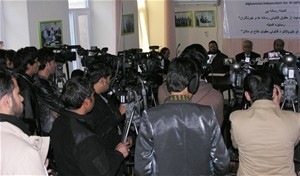 Afghan media outlets congregate to broadcast the press conference of the Media Law Committee at the Afghanistan Independent Bar