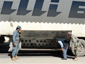 Officials from customs and the border police conduct a joint examination of a truck passing through Hairatan under a new model t