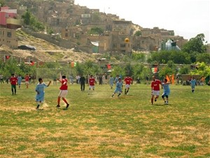 The local football club plays a friendly match on the newly laid pitch in Baghe Qazi