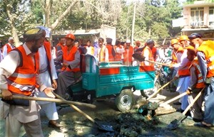 Taloqan residents joined their Major in the cleanup of business areas after Eid festivities