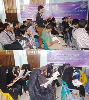 Young men and women discuss ideas at a forum in Zaranj