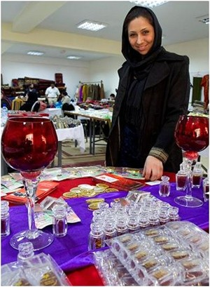 An Afghan businesswoman sells saffron at a two-day exhibition organized by USAID.