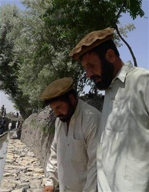 In Khost province in eastern Afghanistan, skilled laborers work with unskilled villagers to repair the canal network`