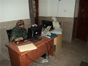 Female data entry clerks enter parcel registration data at the City Hall in Kandahar.