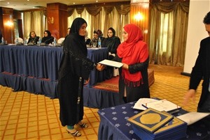 A student receives an award for academic excellence at an event commemorating International Women's Day in Kabul on March 9, 201