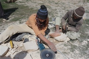 A construction site in Mazar-e-Sharif, where Gul Alam and other trainees receive on-the-job instruction in stone-cutting
