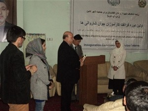 Arezu receives her certificate of participation in the internship program from the mayor of Herat