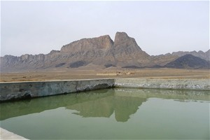 Demrasi's repaired reservoir sits at the foot of the mountains
