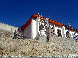 Masons and laborers in Khost's Shamal district hard at work repairing the only high school in the area