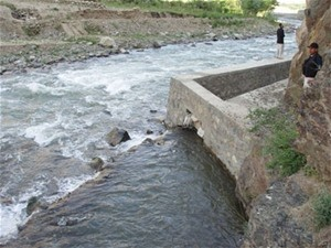 The rehabilitated Karaste Canal channels water to low-lying farms and sloping and upland fields in Tagab District, spurring agri