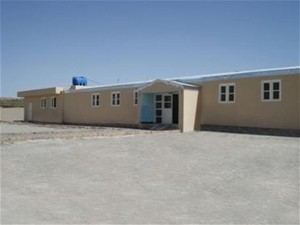 AFTER: Through USAID, the clinic received a major refurbishment and a newly constructed wing. The roof, building exterior, inter