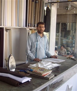 A young man learns how to run a tailoring business as part of an apprenticeship program for day laborers in Jalalabad.