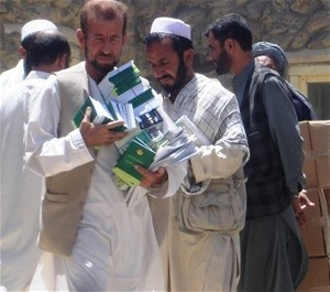 Community Cultural Center volunteers distribute information about access to justice, legal rights, and women's rights in Parwan