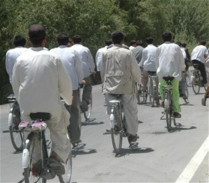 Every day over 400 bicyclists ride over the Pul-e-Alam road south of Kabul. Many of the riders are students going to-and-from sc