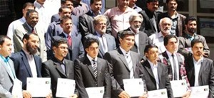 New managers at the Herat Medium Taxpayer Office display their certificates after completing a USAID-funded management training