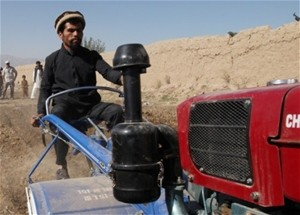 Shah Mohammed demonstrates his family's new two-wheel tractor. The tractor will enable Mohammed and his five brothers to cultiva