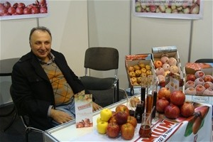 An Afghan entrepreneur displays his fresh fruit at the trade fair in Moscow.