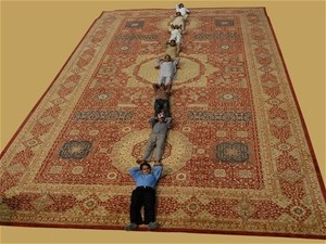 Afghan carpet makers enjoying their time at Domotex 2010.