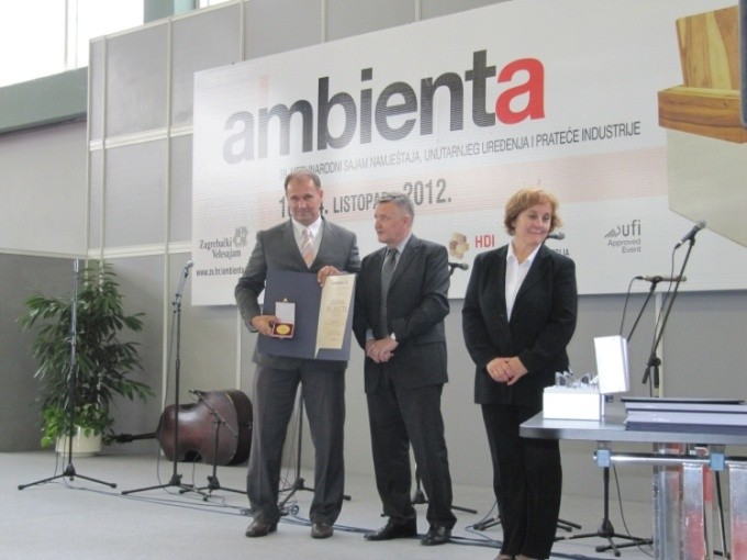Husein Taletovic of Rattan Sedia Co., left, receives Golden Plaque and Diploma at Ambienta Trade Fair in Zagreb.