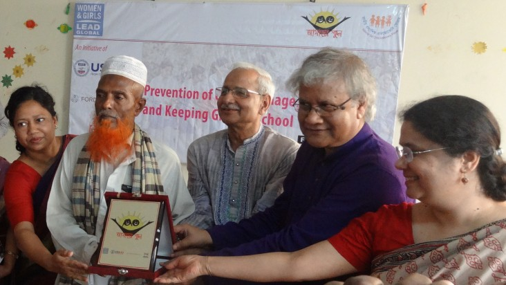 Abdul Majid, second from left, is recognized for his commitment to educating his three daughters.