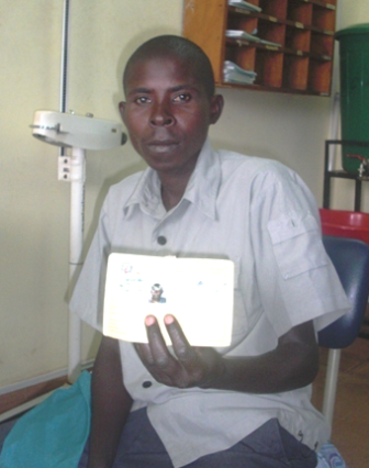 Diogene displays his insurance card at the health clinic.