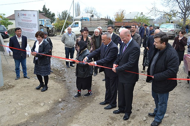 Community members in Piramsan village inaugurate new electricity lines installed with USAID support