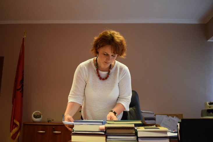 Chief Judge Enkeledi Hajro of the Tirana District Court reviews her documents.