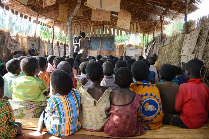 "A volunteer teacher discusses the letter ""n"" at an after-school reading camp in Mbeti, Malawi."