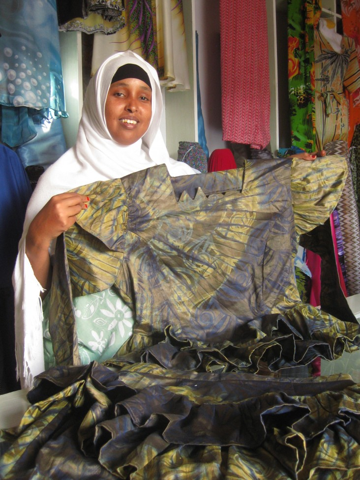 Qani Abdi Alin, the founder of Dheeman Enterprise, shows off one of her designs.