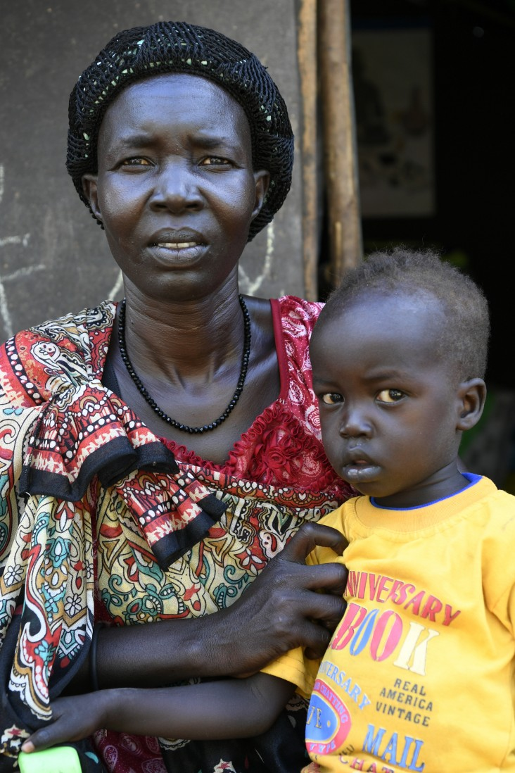 Nyantau Machoch, a South Sudanese refugee who fled conflict to neighboring Ethiopia, with one of her six children.
