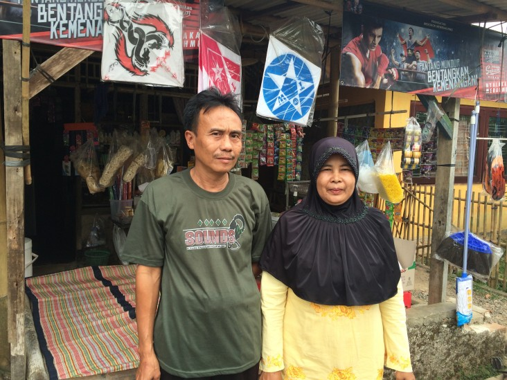 Nurita and her husband in front of their business