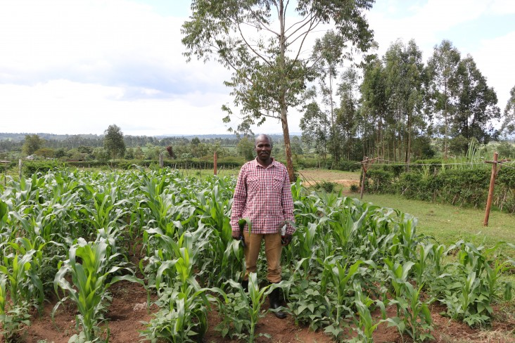 Stanley Kimeli stands proudly next to his improved harvest.