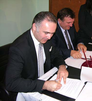 Signing the first commercial loan to a local government unit in Albania.
