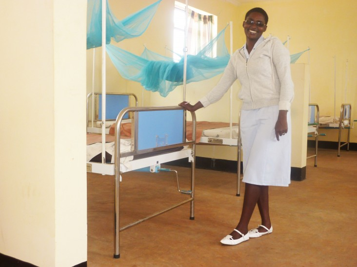A nurse at the Kibaigwa Health Center shows off the newly completed women's ward.