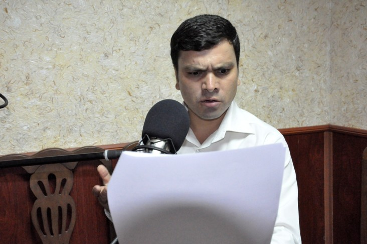 An actor performs at the Supreme Court's radio studio, recording his voice for a radio drama promoting women's rights.